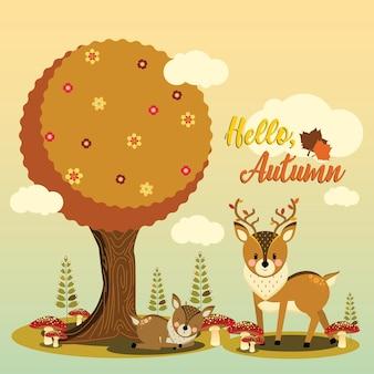 Ciervo de otoño debajo del árbol