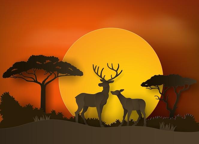 Ciervos en el bosque con puesta de sol. arte en papel y estilo artesanal.
