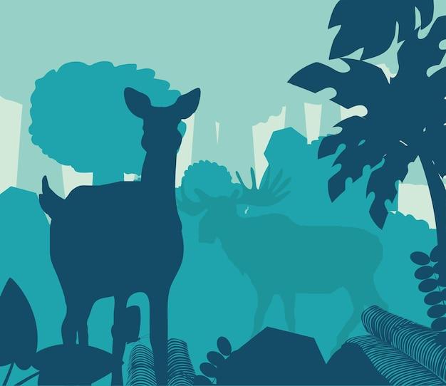 Ciervos de silueta en el bosque