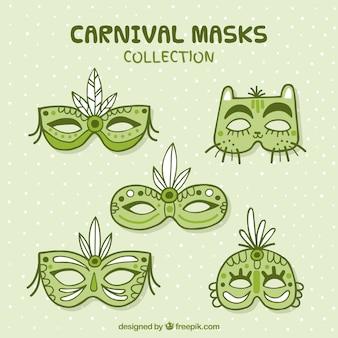 Cinco máscaras de carnaval dibujadas a mano