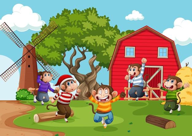 Cinco monitos saltando en la escena de la granja.