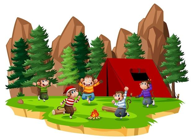 Cinco monitos saltando en la escena del parque sobre fondo blanco.