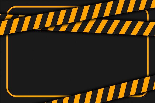 Cinta de advertencia o precaución sobre fondo negro