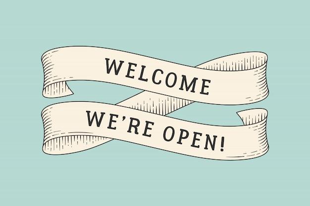 Cinta con inscripción bienvenido estamos abiertos