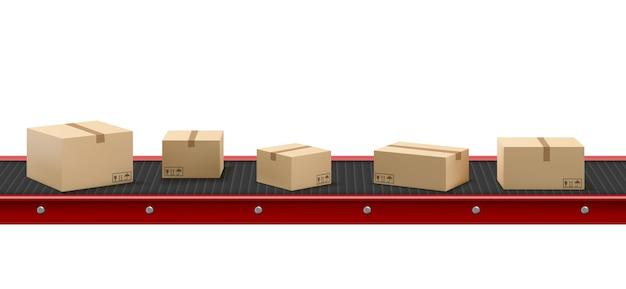 Cinta transportadora con cajas de cartón en la fábrica.