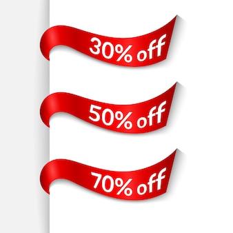 Cintas rojas con texto 30% 50% 70% de descuento sobre fondo blanco aislado