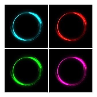 Círculos de fuego glwing de diferentes colores sobre fondo negro.