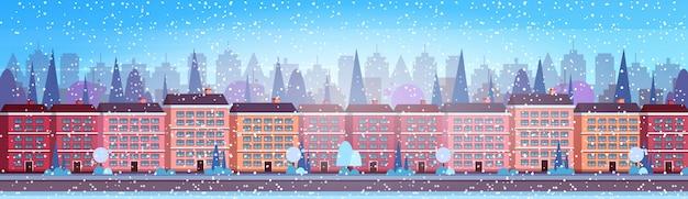 Ciudad edificio casas invierno calle paisaje urbano fondo feliz navidad feliz año nuevo