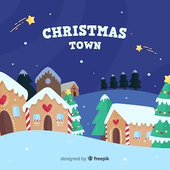 Ciudad navideña en diseño plano