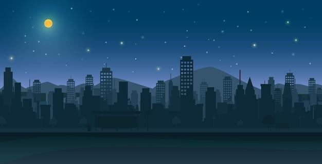 Ciudad de noche con luna y estrellas.