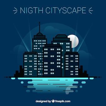 Ciudad nocturna con rascacielos