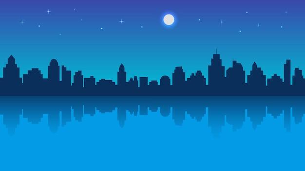 Ciudad nocturna con reflejo y cielo estrellado.