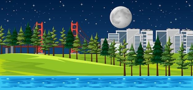 Ciudad con paisaje de parque natural en la escena nocturna.