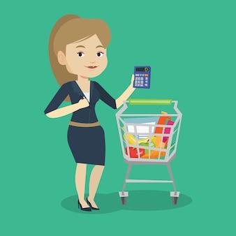 Cliente femenino contando con calculadora.