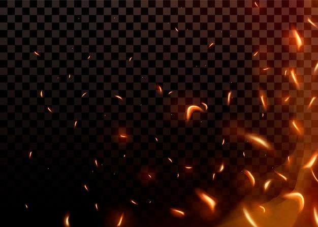 Close-up chispas ardientes calientes y partículas de llama