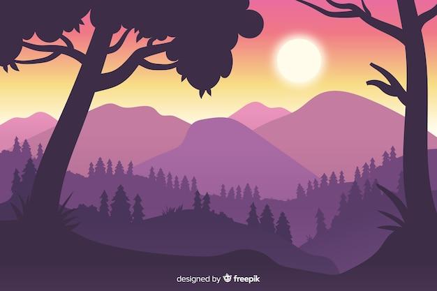 Close-up siluetas de árboles y montañas