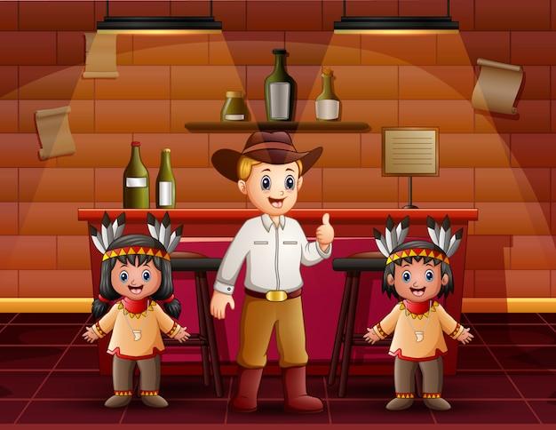 Un coboy masculino con niño indio en el bar
