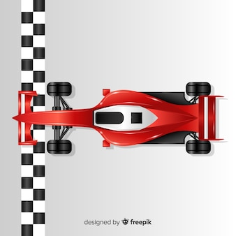 Coche de formula 1 brilloso rojo pasando línea de meta