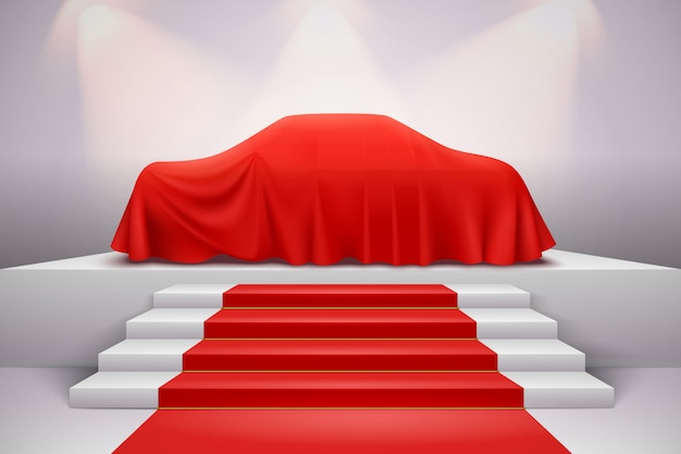 Coche de lujo cubierto con una presentación de tela drapeada de seda roja en el podio con alfombra de escalera realista