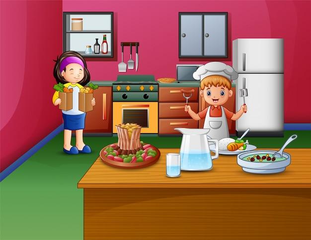 Cocina feliz con hermana y hermano.