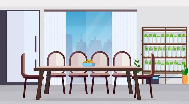 Cocina moderna sin gente diseño de interiores mesa de comedor redonda grande con plato de frutas y verduras plantas inteligentes concepto de sistema plano horizontal