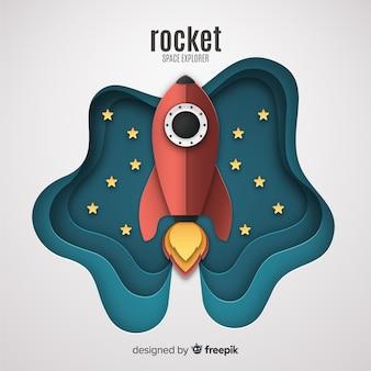 Cohete adorable con estilo de arte de papel