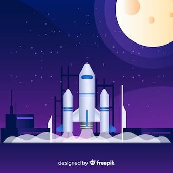 Cohete en degradado sobre plataforma de lanzamiento