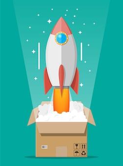 Cohete de dibujos animados expulsado de la caja de cartón. concepto de puesta en marcha, idea creativa, liderazgo, éxito empresarial o inspiración. despegue de la nave espacial.