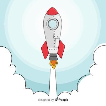 Cohete espacial adorable dibujado a mano