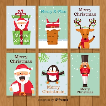 Colección adorable de tarjetas de navidad con diseño plano