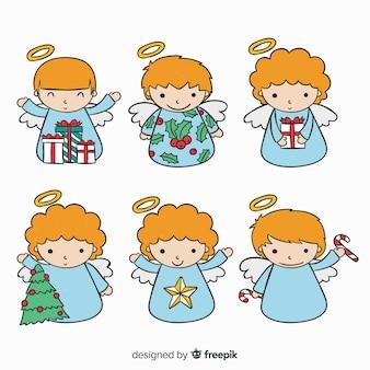 Colección de adorables ángeles de navidad dibujados a mano