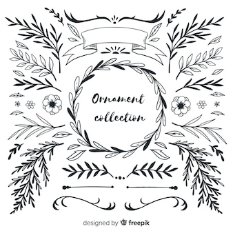 Colección de adornos dibujados a mano de hojas y flores