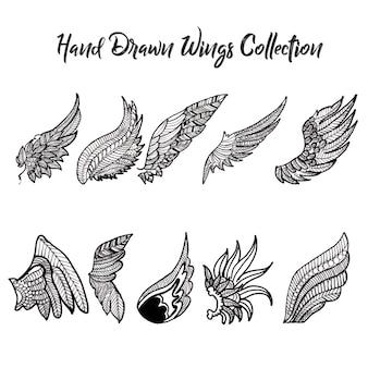Colección de alas blancas y negras dibujadas a mano