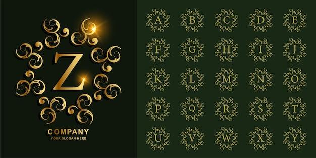 Colección alfabeto inicial con adornos de lujo o plantilla de logotipo dorado de marco floral.