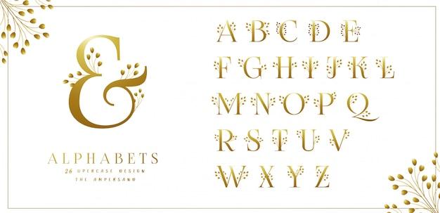 Colección de alfabetos florales dorados