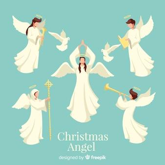 Colección de ángeles de navidad en diseño plano