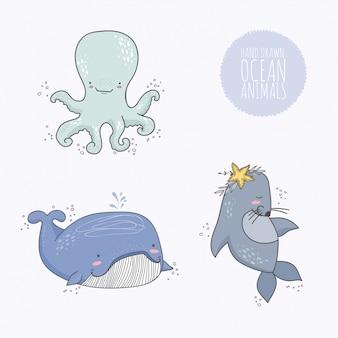 Colección de animales dibujados a mano del océano.