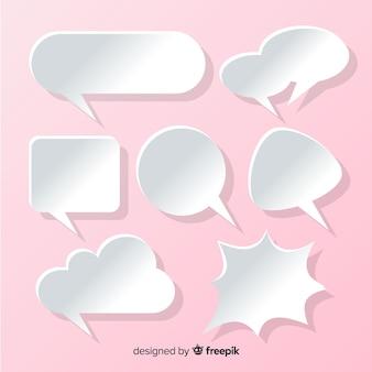 Colección de burbujas de discurso plano en papel estilo fondo rosa
