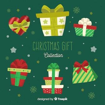 Colección de cajas de regalos de navidad en diseño plano