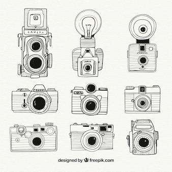 Colección de cámaras en blanco y negro dibujadas a mano