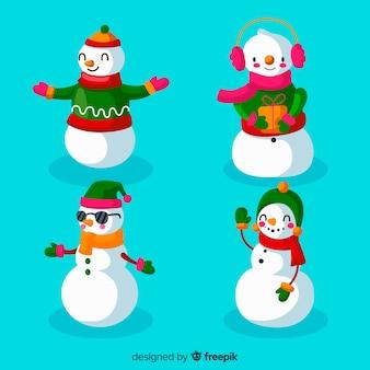 Colección del carácter del muñeco de nieve en diseño plano