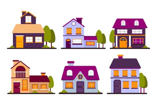 Colección de casas urbanas de colores con árboles.