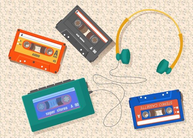 Colección de cintas con auriculares y reproductor de casetes.