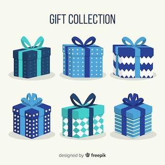 Colección colorida de cajas de regalos de navidad en diseño plano