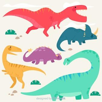 Colección colorida de dinosaurios en diseño plano