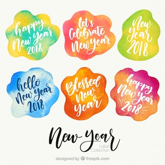 Colección colorida de insignias de año nuevo 2018 en acuarela