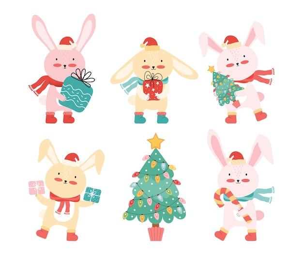 Colección de conejos con gorro de papá noel con un árbol de navidad y regalos