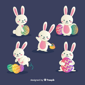 Colección conejos de pascua dibujados a mano con huevos