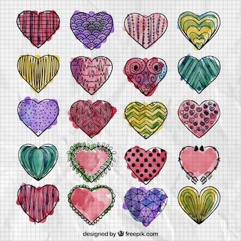 Colección de corazones dibujados a mano en acuarela