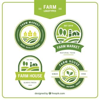 Colección de cuatro logos verdes de granja
